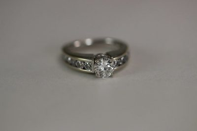 solitaire diamond ring with diamonds on shank
