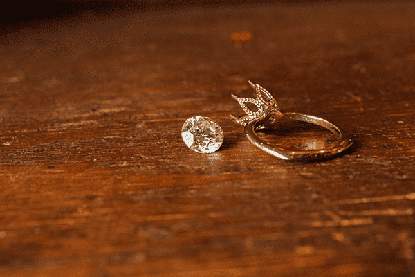 Custom Six Prong Floral Engagement Ring with Diamond on Wood