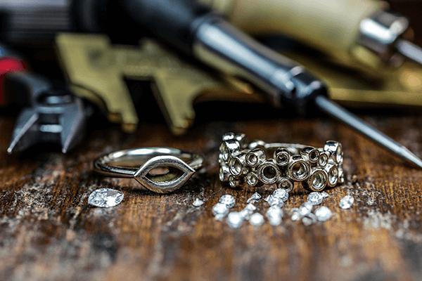Loose Diamonds with McCoy Custom Rings on Wood